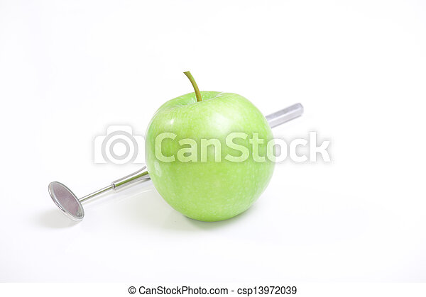Green apple and dental tools isolated on white  - csp13972039