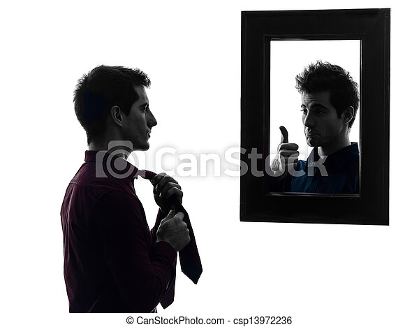 man in front of his mirror dressing up silhouette - csp13972236