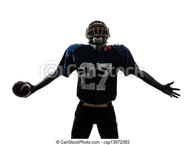 triumphant american football player man silhouette - csp13972383