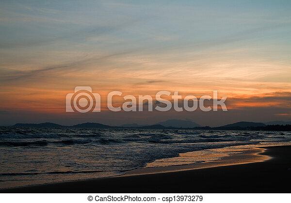 Tropical beach at beautiful sunset. Nature background   - csp13973279
