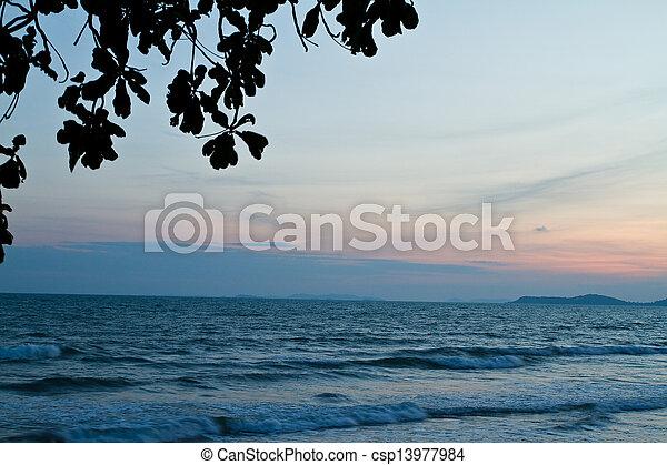 Tropical beach at beautiful sunset. Nature background   - csp13977984