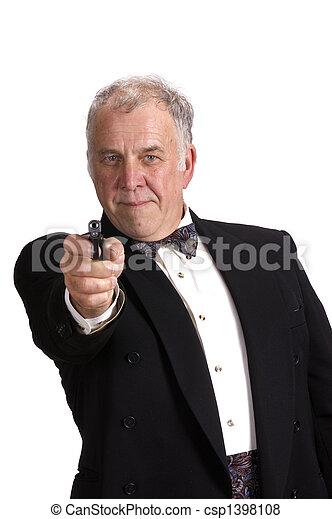 older businessman impersonating James Bond - csp1398108