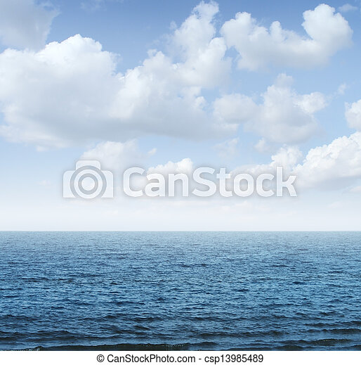 Ocean and sky background as a tranquil scene of nature with a deep blue sea horizon going into infinity on a summer day with blank copy space.