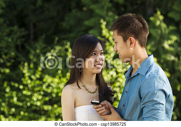 Young Adult happy after proposal for marriage  - csp13985725