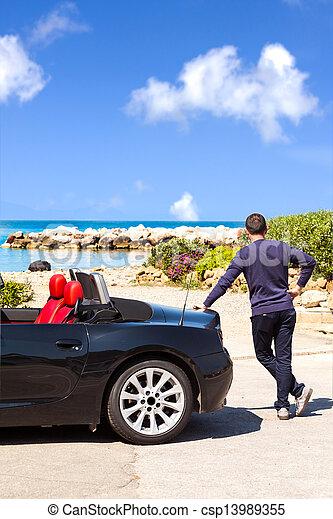 Man With Sport Car On The Beach - csp13989355