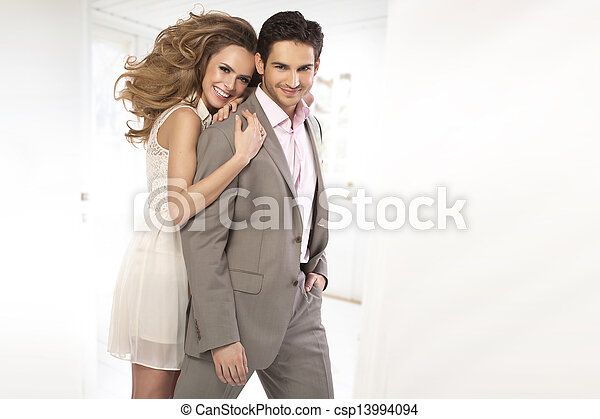 Young brunette man with his charming wife