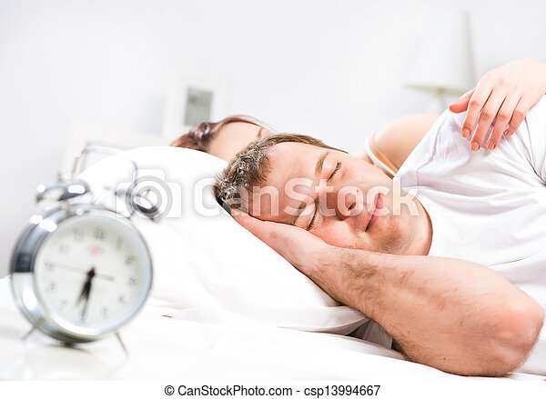 man sleeping in bed - csp13994667