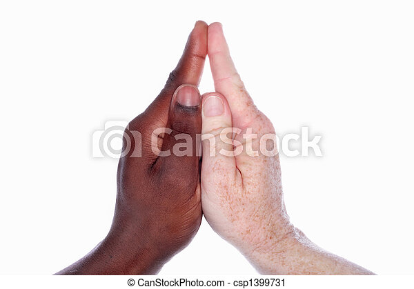 Two hands of different races together form the shape of a church with a steeple (as in the childs hand game)