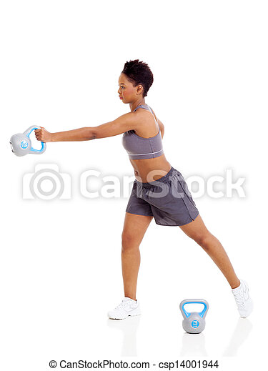 young adult afro american woman doing swing exercise with kettle bell on white background - csp14001944