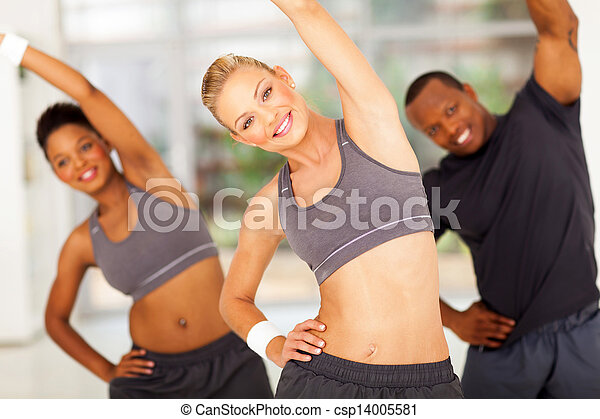 personal trainer exercise with two africans - csp14005581