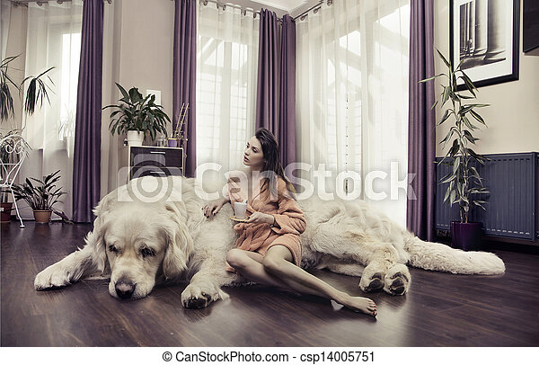 Young woman hugging big dog - csp14005751