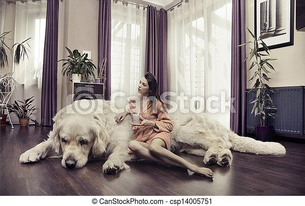 Young woman hugging big dog - csp14005751