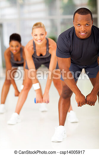 group of people doing fitness exercise with dumbbell - csp14005917