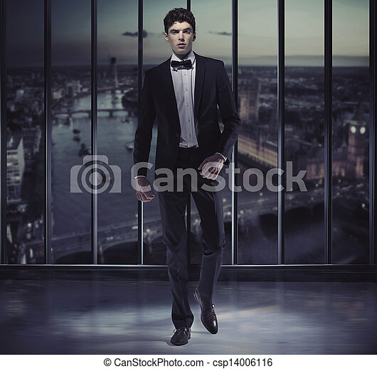 Serious handsome man on the top of the skyscraper - csp14006116