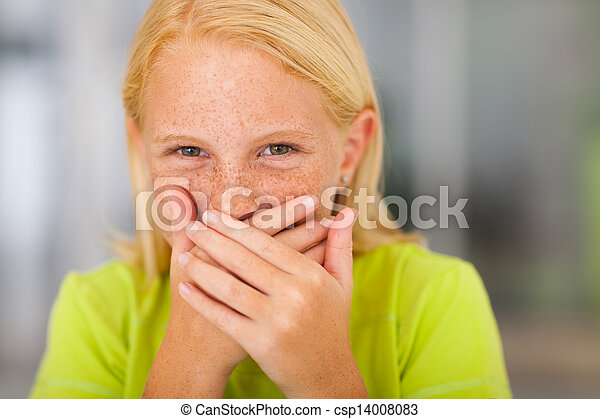 happy preteen girl covering her mouth and laughing - csp14008083