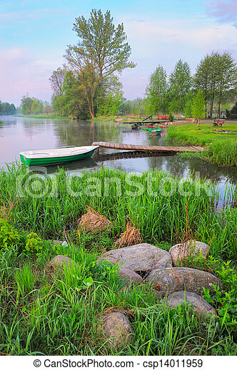 Rural landscape with boat and footbridge on the Narew river after fog, Poland. - csp14011959