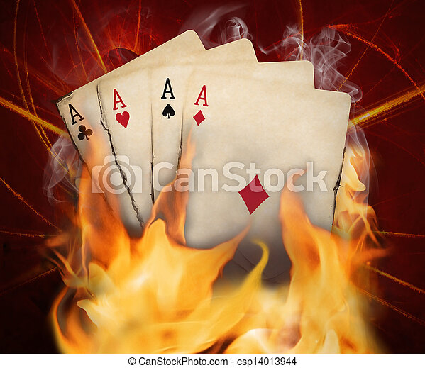 Poker cards burn in the fire - csp14013944