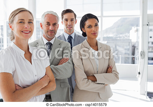 Smiling business people standing to - csp14015579