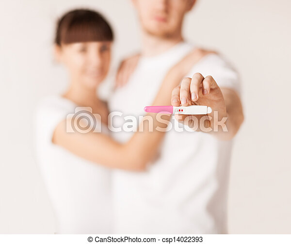 woman and man hands with pregnancy test