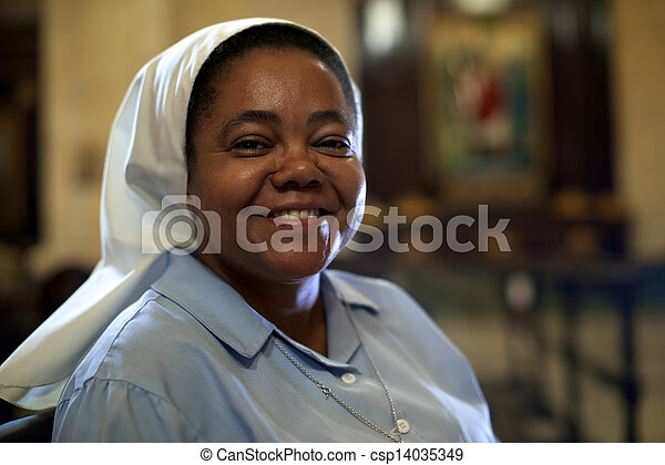 Woman and religion, portrait of catholic nun praying in church and looking at camera - csp14035349