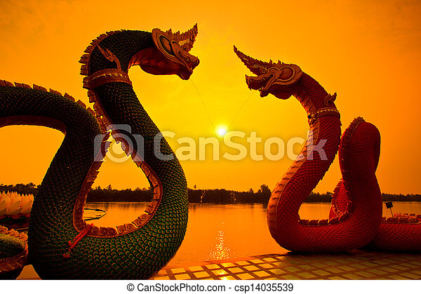 Silhouettes dragon and Naga statue protecting Thai temple - csp14035539