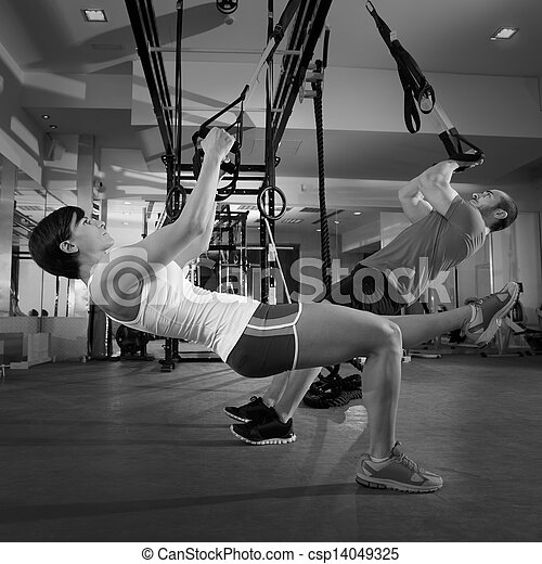 Fitness TRX training exercises at gym woman and man - csp14049325