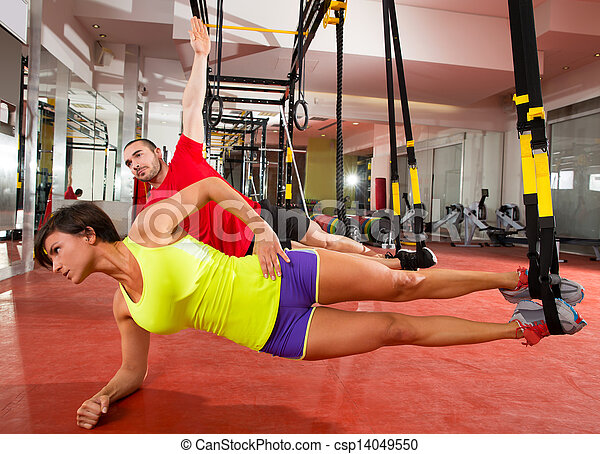 Fitness TRX training exercises at gym woman and man - csp14049550