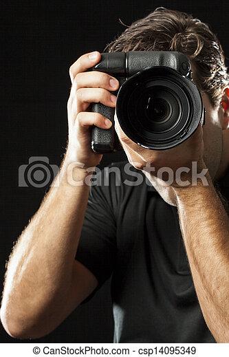 Photographer on black.
