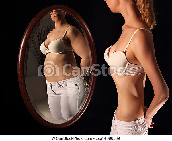 Skinny woman seeing herself fat in a mirrow - csp14096569