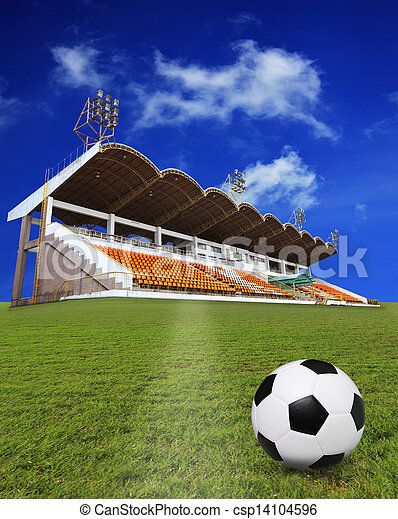 soccer football on green field with stadium background use for soccer theme