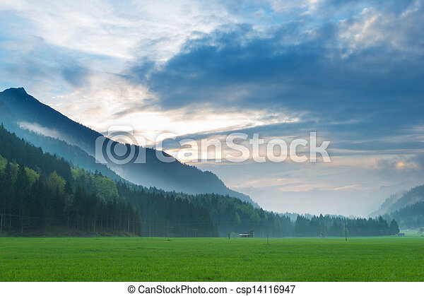 mystical 	sunset in tyrol alps with forest and dramatic sky - csp14116947