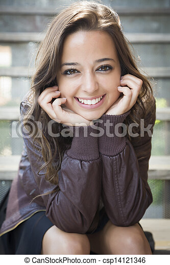 Mixed Race Young Adult Woman Portrait on Staircase - csp14121346