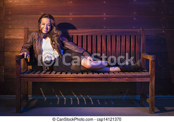 Mixed Race Young Adult Woman Portrait Sitting on Wood Bench - csp14121370