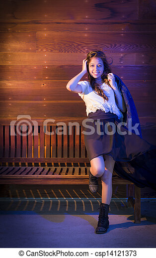 Mixed Race Young Adult Woman Portrait Against Wooden Wall - csp14121373