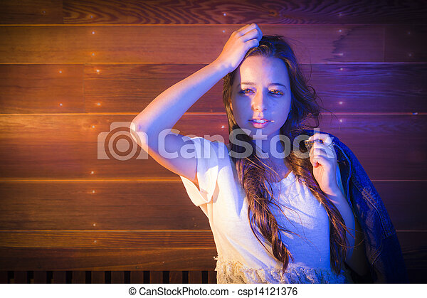 Mixed Race Young Adult Woman Portrait Against Wooden Wall - csp14121376