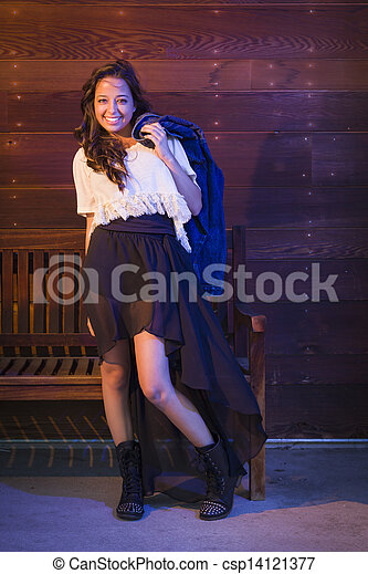 Mixed Race Young Adult Woman Portrait Against Wooden Wall - csp14121377