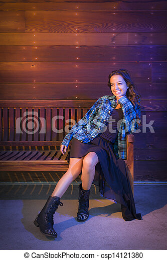 Mixed Race Young Adult Woman Portrait Sitting on Wood Bench - csp14121380