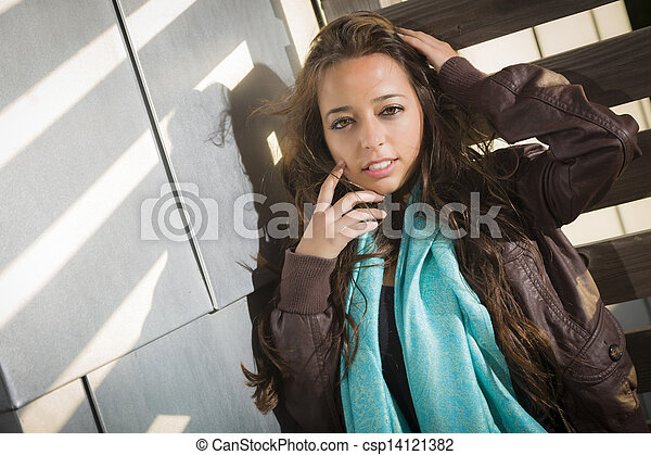 Mixed Race Young Adult Woman Against a Wood and Metal Wall - csp14121382