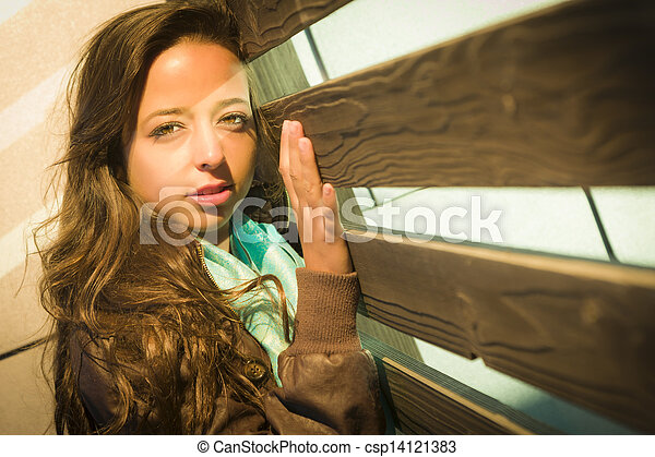 Mixed Race Young Adult Woman Against a Wood Wall Background - csp14121383