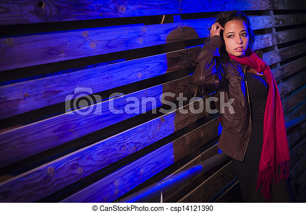 Mixed Race Young Adult Woman Against a Wood Wall Background - csp14121390