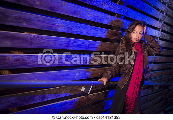 Mixed Race Young Adult Woman Against a Wood Wall Background - csp14121393