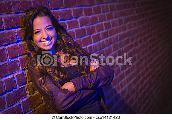 Pretty Mixed Race Young Adult Woman Against a Brick Wall - csp14121428
