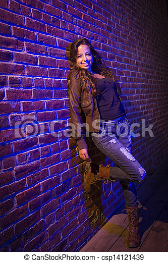 Pretty Mixed Race Young Adult Woman Against a Brick Wall - csp14121439