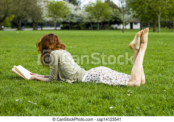 Young woman reading in the park - csp14123541