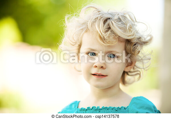 Adorable little girl taken closeup outdoors in summer - csp14137578