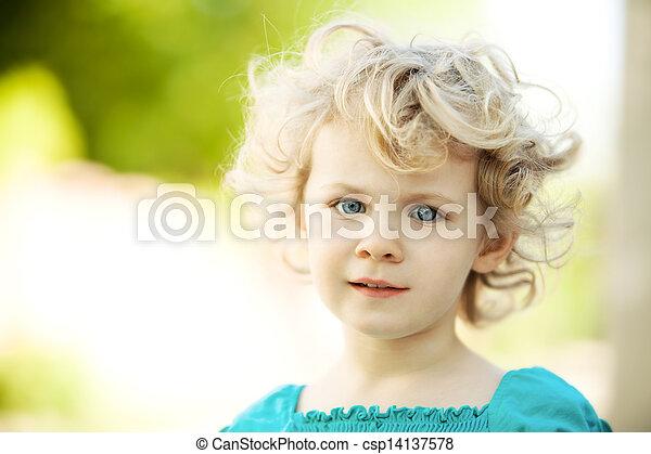 Adorable little girl taken closeup outdoors in summer - csp14137578