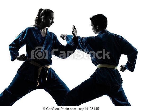 karate vietvodao martial arts man woman couple silhouette - csp14138445