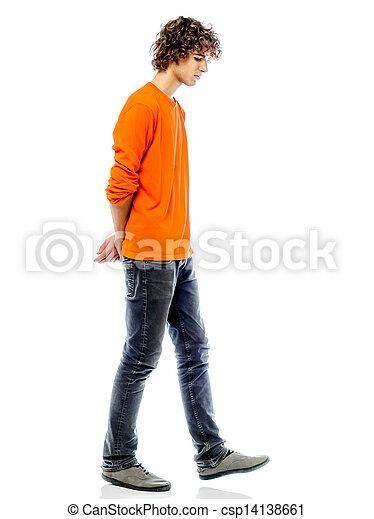 young man walking sad bore side view - csp14138661