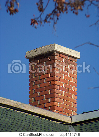 An aging red brick chimney on a clear day. - csp1414746