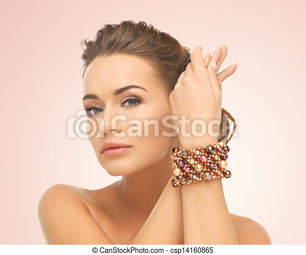 woman wearing bracelet with beads - csp14160865